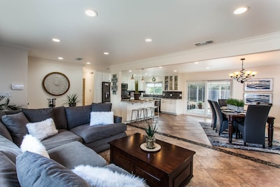 Open Living Room with Dining room and Kitchen adjacent. Perfect for entertaining