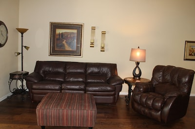 living room with queen sofa and recliner