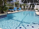 A reel-out pool cover is provided during the cooler months to minimize heat loss