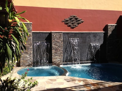 1st level private patio spa, pool, and water walls