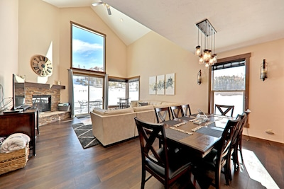 Beautiful sunny great room with huge windows to take in the views.