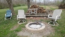 Fire Pit with swinging grill grate!  Wood is provided!