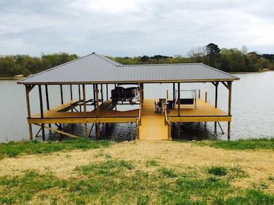 Large Private Dock with swimming, eating area, lounging area.