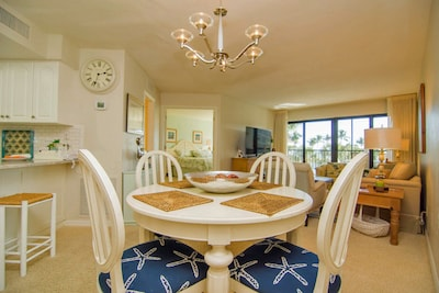 Open floor plan from kitchen to dining to den