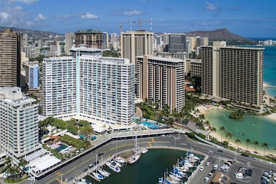 The iconic Ilikai building with Yacht harbor, lagoon and Hilton Hawaiian Village