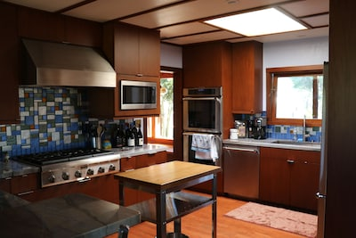 Professional Grade Kitchen with custom glass backsplash.