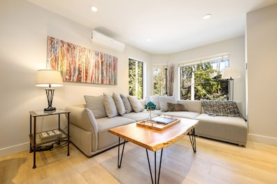 Bright, open and airy define the main living level of this luxurious townhome