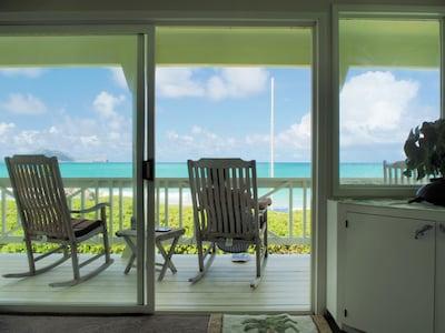 Living room to Lanai.  4 teak Rockers, 2 teak Steamer Chairs,