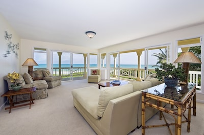 Living room with ocean and beach views