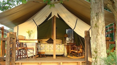 The perfect place to hide away!  Sleeping, rocking & dining on raised platform.