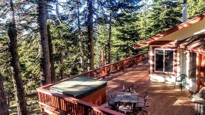 Hot tub & wrap-around redwood decks overlook Natl. Forest, mountains, & valleys.