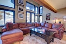HUGE leather sectional in great room with original artwork and ski Mt. views!!