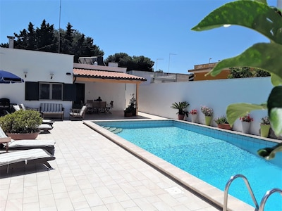 Outdoor living is what it's all about, solar heated pool, sun drenched courtyard