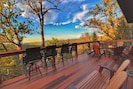 Main floor deck with fire pit, bar top seating, and million dollar views!