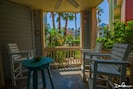 Enjoy eating and drinking at this patio! Steps to the pool thru the patio gate
