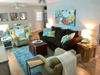 Curl up with a good book, watch a movie or play a board game in the living area.