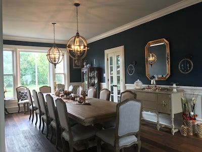 The French-country stile Dining Room table seats up to 16