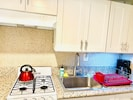 Kitchen with all the kitchenware you need.      Granite countertops, too.