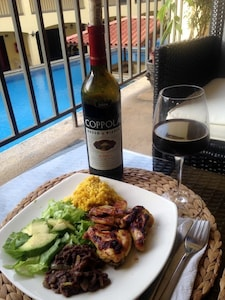 """Indulging Homemade """"Casado"""" & Red Wine on my semi-private deck."""