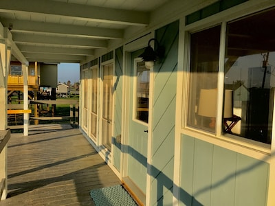 Pelican Cottage has a great front deck that looks out onto the ocean