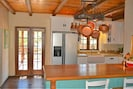 Kitchen and french door to breakfast deck.