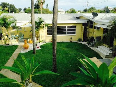 Aerial view of the back yard.  2 bedroom & patio L -1 bedroom on R
