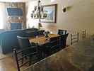 Granite dining table for 6 plus bar area allows ample eating room for your group