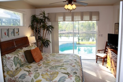 Master Bedroom with King Bed - with views of the pool and the conservation lands