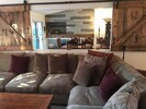 Barn doors may be closed to dining area for complete surround sound experience.