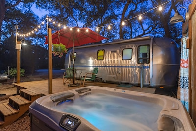 Our hot tub under the twinkle lights is super romantic.