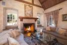 Spacious Living Area w/ Grand Fireplace