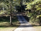 Long private drive into 2-acre property on a cul-de-sac