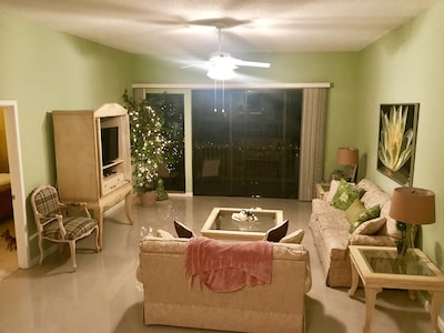 Spacious living room with brand new porcelain floor, walk out to balcony