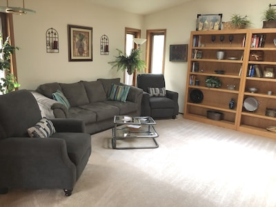 Spacious living room with large screen tv