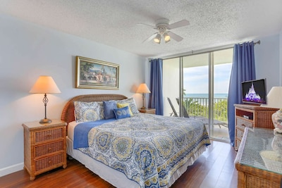 Master Bedroom with King Size Bed, Flat Screen TV and Access to Private Covered Balcony