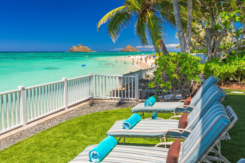 This beachfront Oahu Airbnb features direct views over Lanikai Beach and the Mokulea
