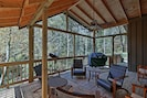 Enjoy fabulous forest views from the covered deck!