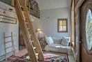 You'll find a cozy futon and custom wooden ladder leading up to the loft.