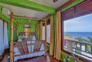 Cocoa Suite (Queen). Private, with picturesque Caribbean Sea views.