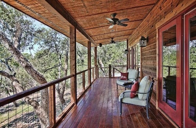 Enjoy the serenity of nature on the magnificent wrap around deck.