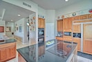 The kitchen is fully equipped with granite counters, a large island, and state-of-the-art appliances.