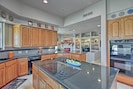 Utilize the pristine kitchen to treat the family to a home-cooked evening meal.