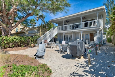 Endless Summer B - Beach Side of the Back of the Building.  Plenty of lounge chairs, 2 picnic tables, gas Grill.  Ground Floor 1 Bedroom on the south side