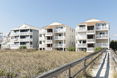 Oceanside view of condo complex and community beach access.