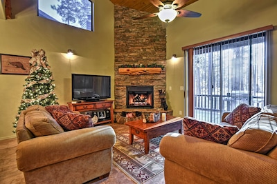 The living room provides modern furnishings and a gas fireplace.