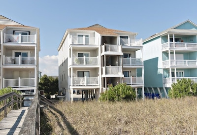 View of the complex from the beach side. Unit is on the second level.