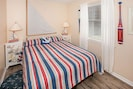 Guest room w/queen bed in nautical decor