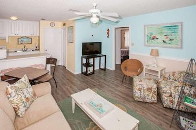Living room w/sleep sofa, side chair and ottoman and coffee table