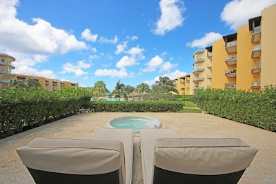 Enjoy Aruba's weather on your private terrace with a hot tub and resort pool view