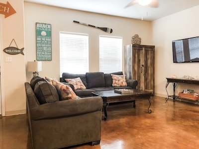 Living area with TV with cable.